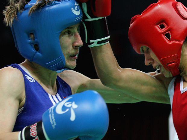 Karolinę Michalczuk (L) na pewno zobaczymy na olimpijskim ringu w Londynie (fot. Getty Images)