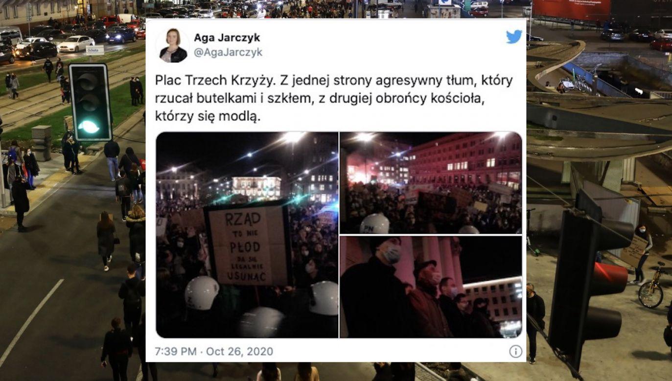 W stronę broniących kościoła poleciały petardy i szkło (fot. tt/AgaJarczyk, PAP/Rafał Guz)