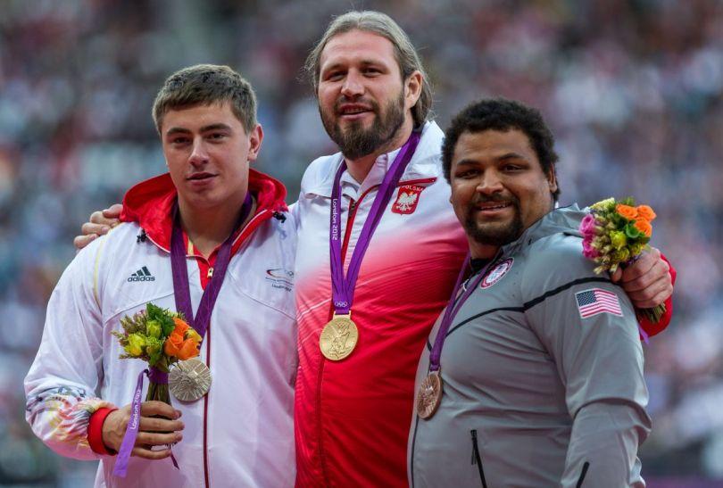 Tomasz Majewski i pozostali medaliści (fot.PAP/EPA)