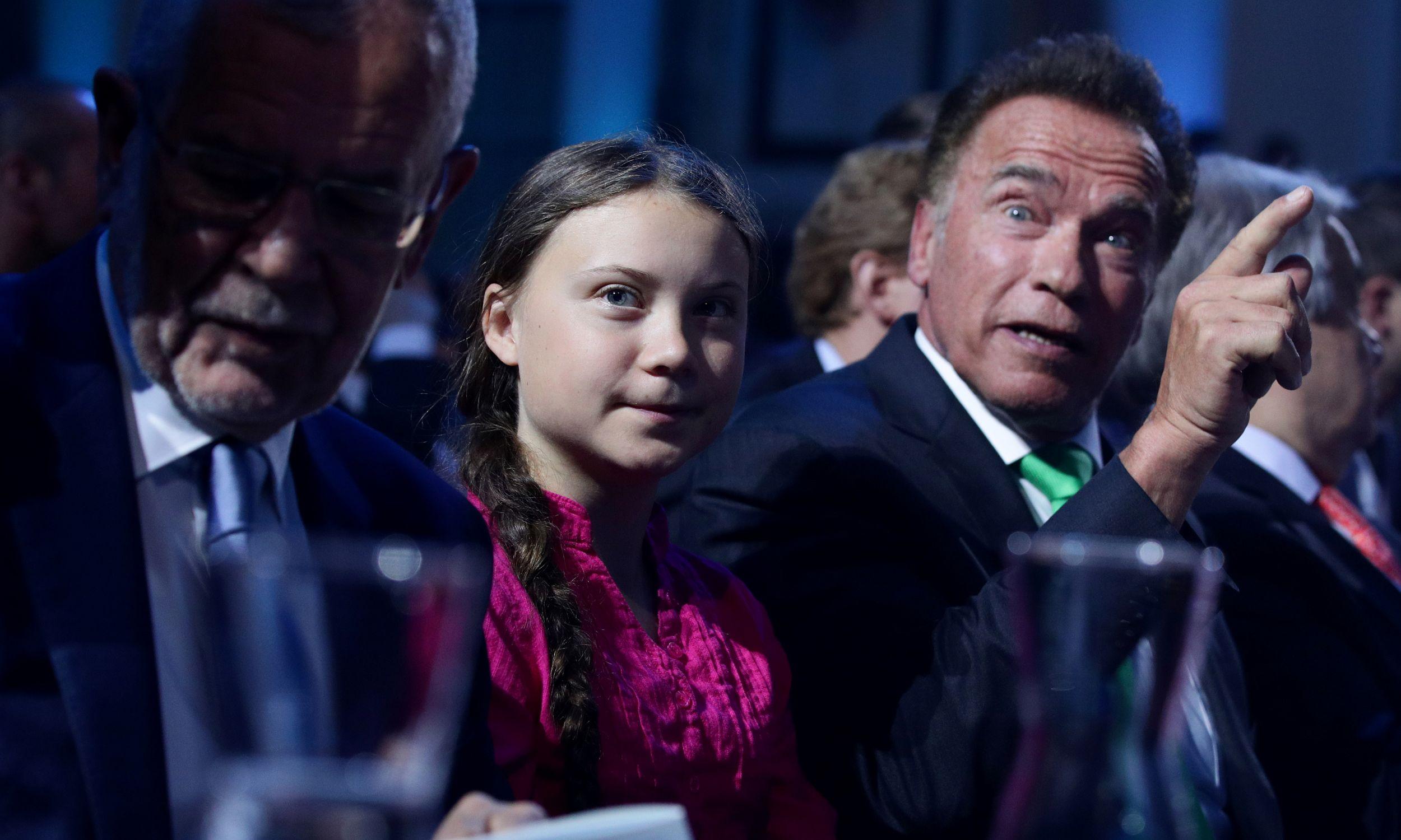 Z byłym gubernatorem Kaliforni Arnoldem Schwarzeneggerem i prezydentem Austrii Aleksandrem Van der Bellenem. Fot. REUTERS/Lisi Niesner